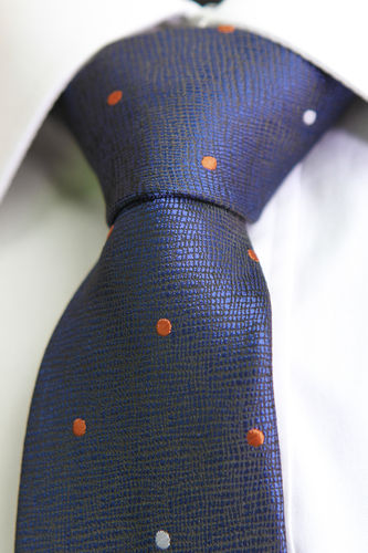 Blue tie orange and white dots